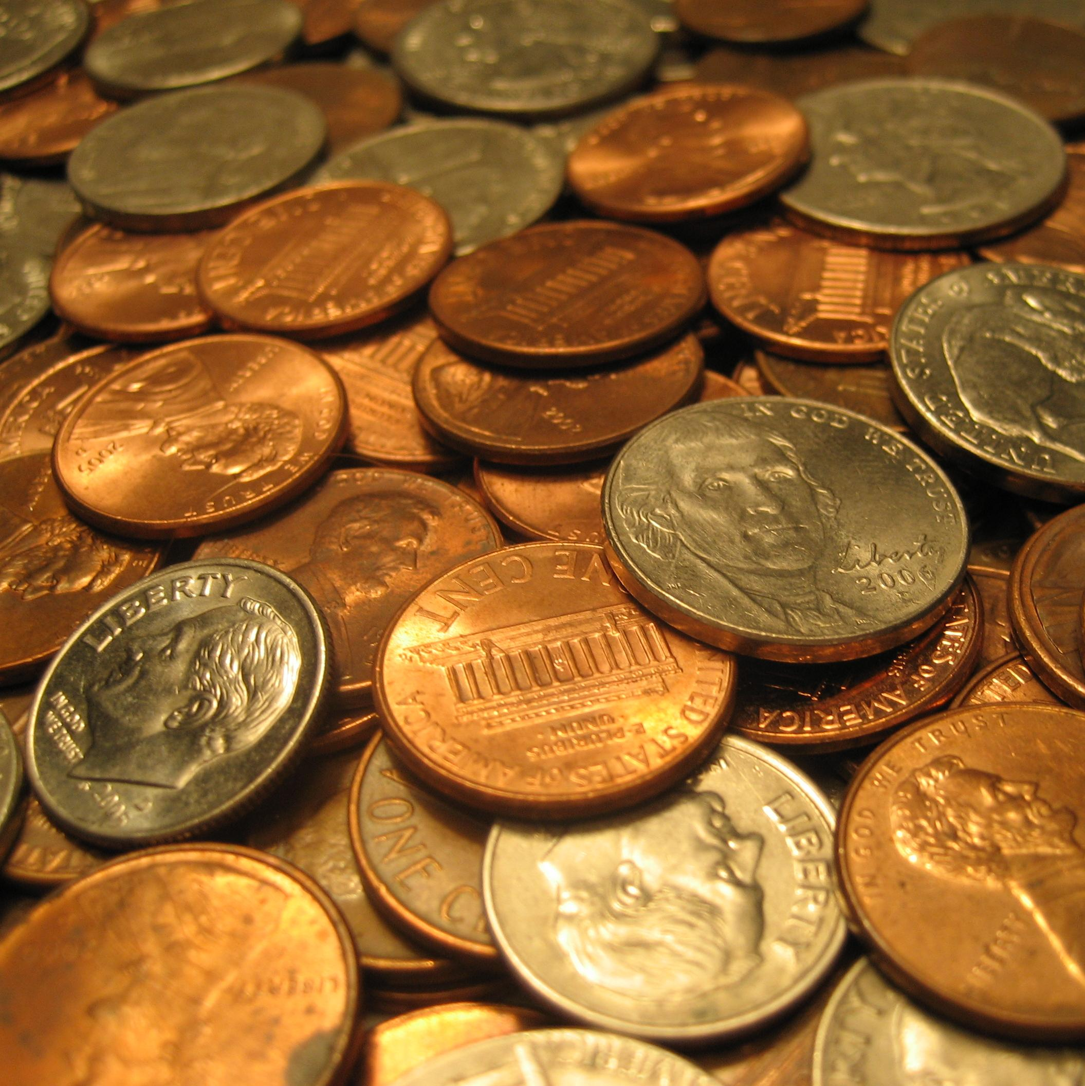 An assortment of United States coins in a pile.