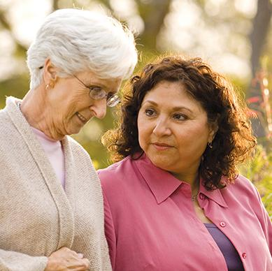 Elderly woman talking with her carer.
