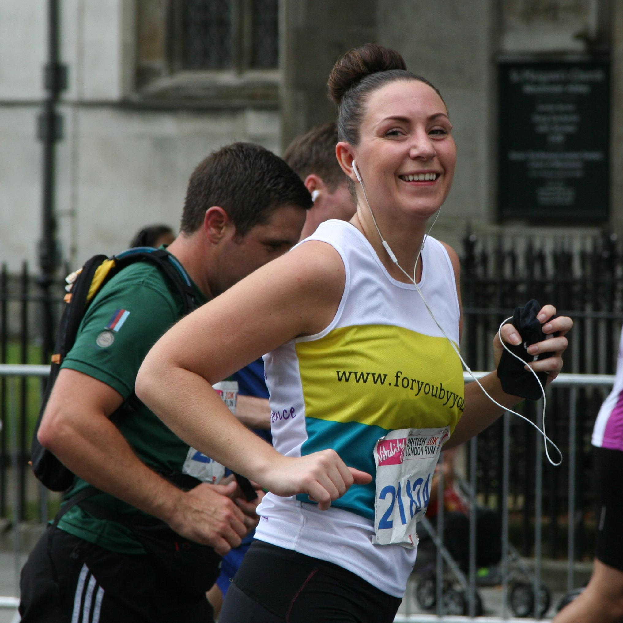 Nicola Jollife runs the British 10k in the Charity for Civil Servants running vest