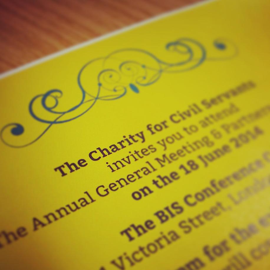 A close of of a yellow invitation to the AGM