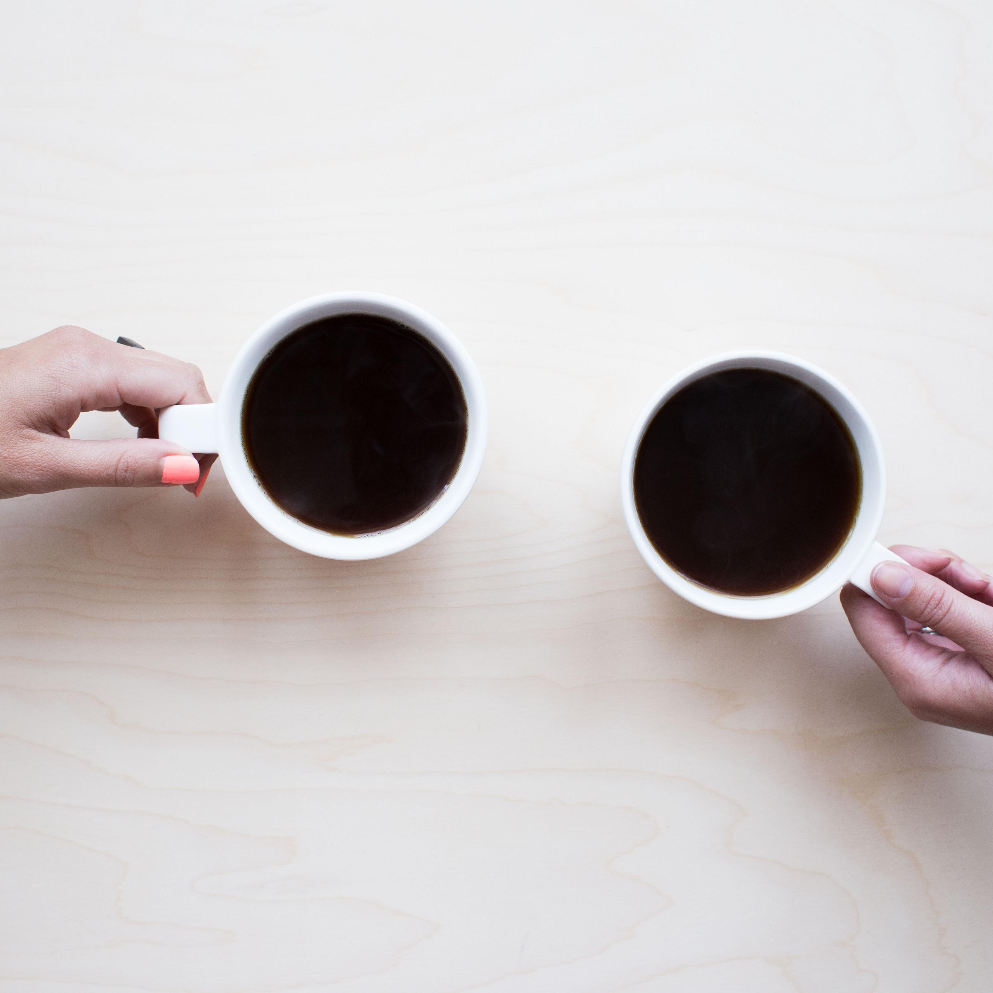 Two cups of coffee on a table